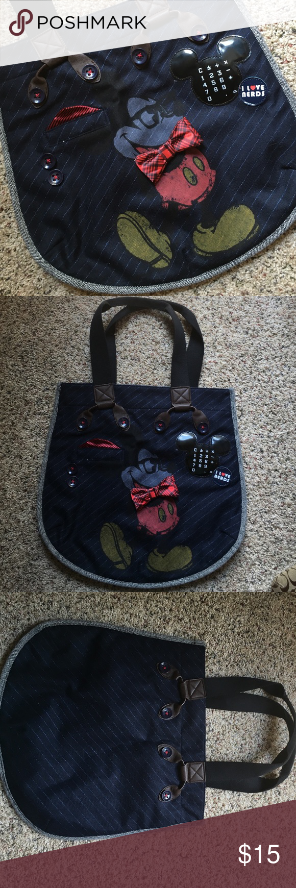 """Authentic Disney Parks Mickey """"Nerd"""" Shoulder Bag Mickey Mouse """"I love Nerds"""" shoulder bag is perfect for back to school! Bag is made of a navy, wool-like material with brown faux leather trim and black canvas straps. It is an authentic Disney Parks product. Measures approximately 16 inches wide by 15 inches tall at widest and tallest points. Very gently used, no rips, tears, or stains. Smoke free home. Disney Bags Shoulder Bags"""