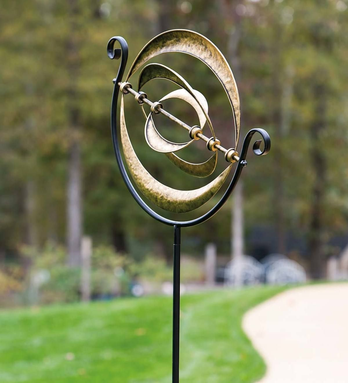 This Simple Yet Elegant Garden Accent Will Make Your Yard Look Out Of This World Our Galactic Metal Win Metal Wind Spinners Wind Spinners Garden Wind Spinners
