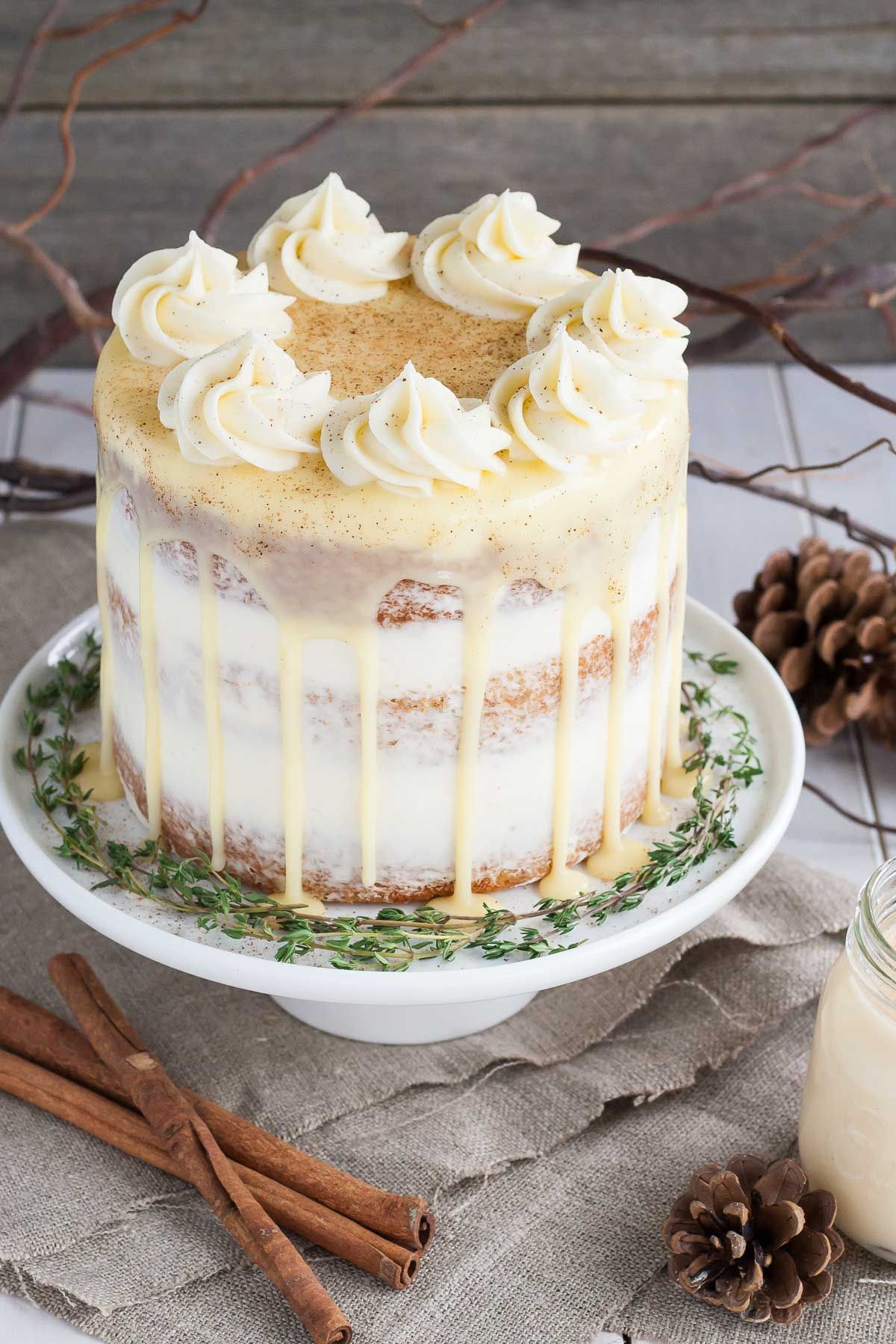 This rum spiked Eggnog Cake with cream cheese frosting and white ...