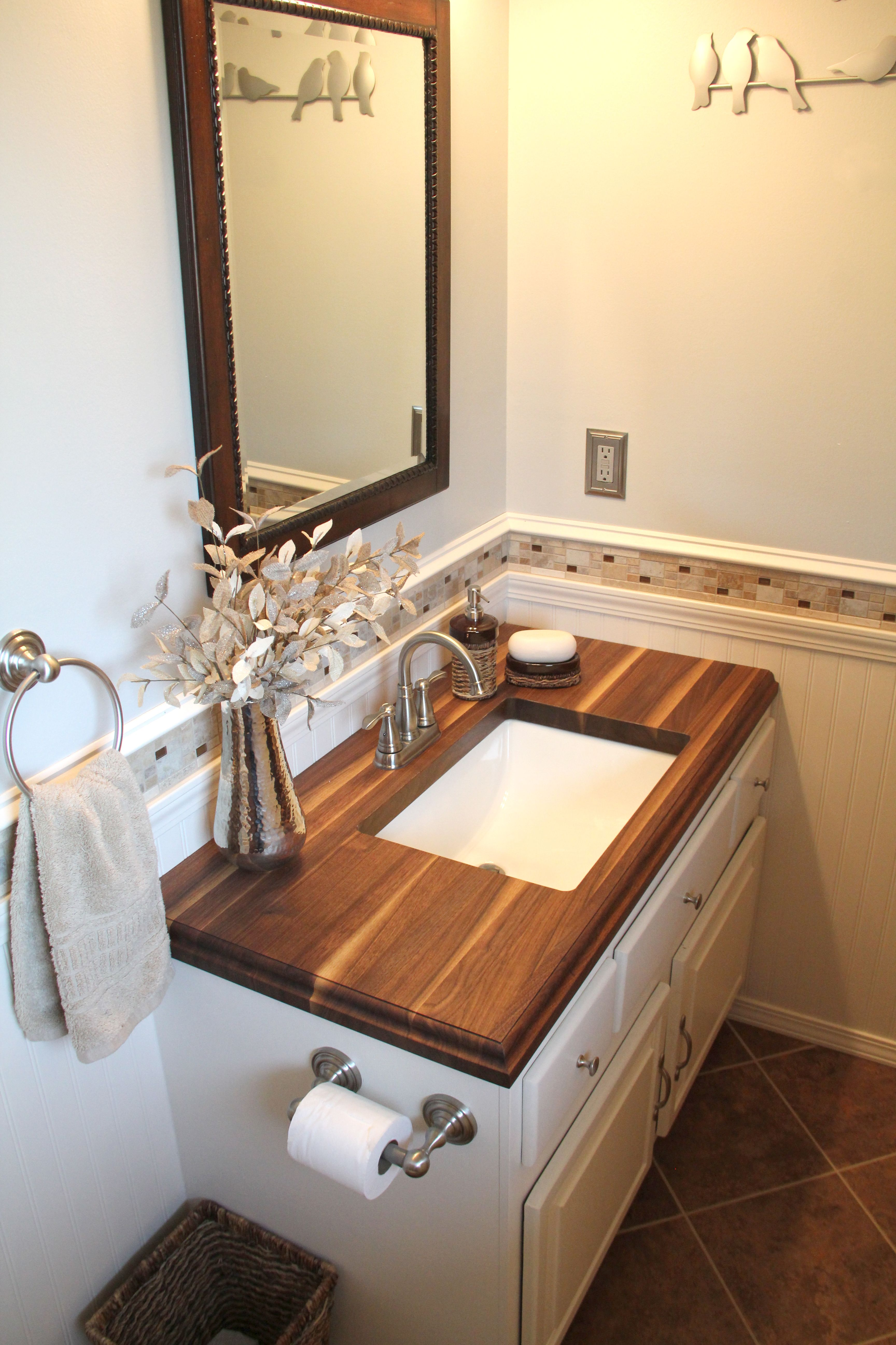 photos of remodeled bathrooms%0A Small bathroom with Walnut Wood counter top