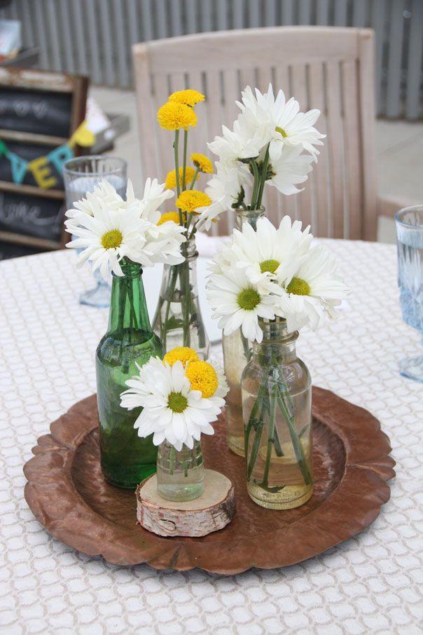 Daisies mums assorted bottles centerpiece orlando