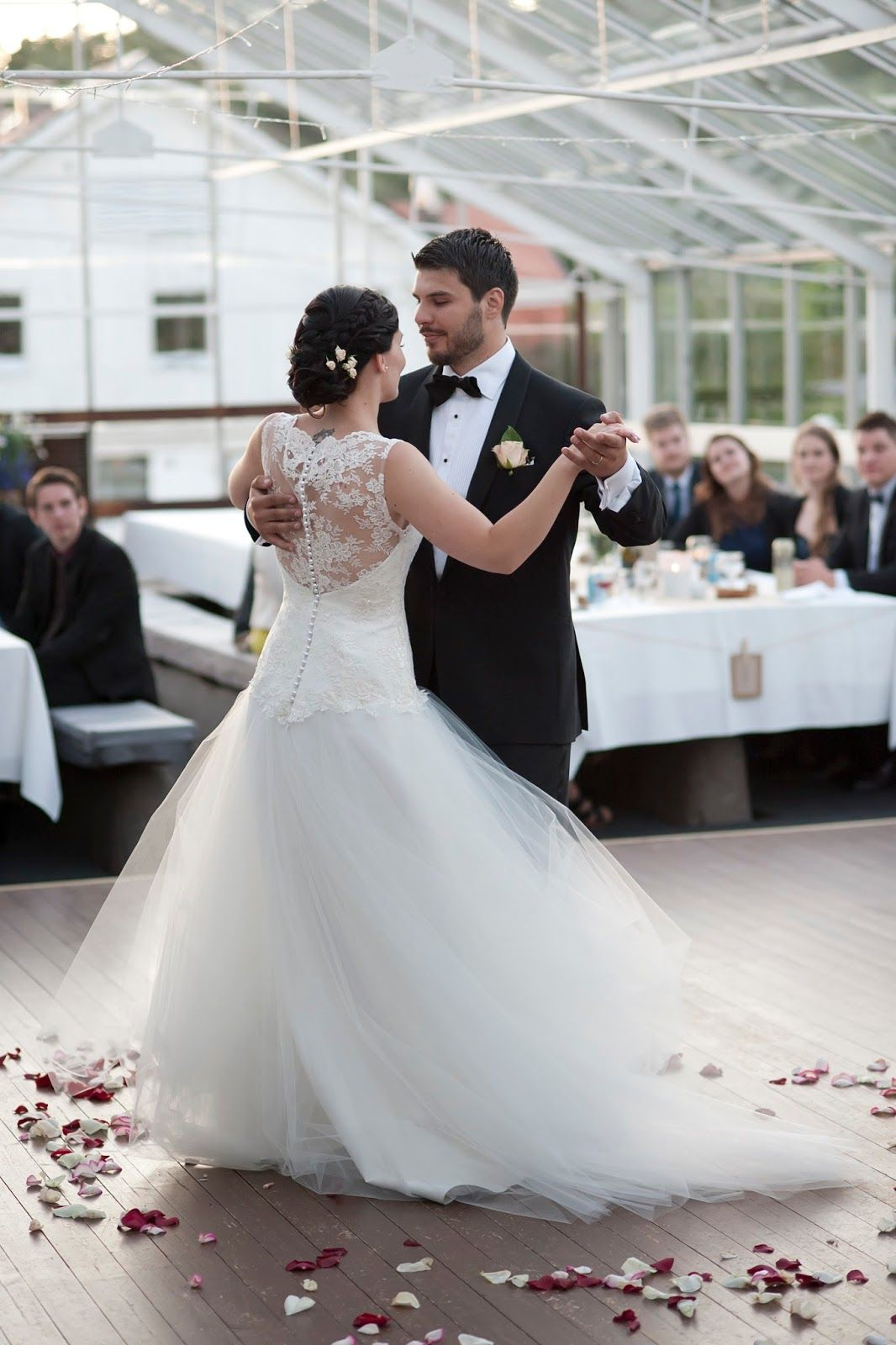 Real wedding in Finland. Dress made by Pukuni (www.pukuni.fi). Wedding dress with lace, tulle and lace back.