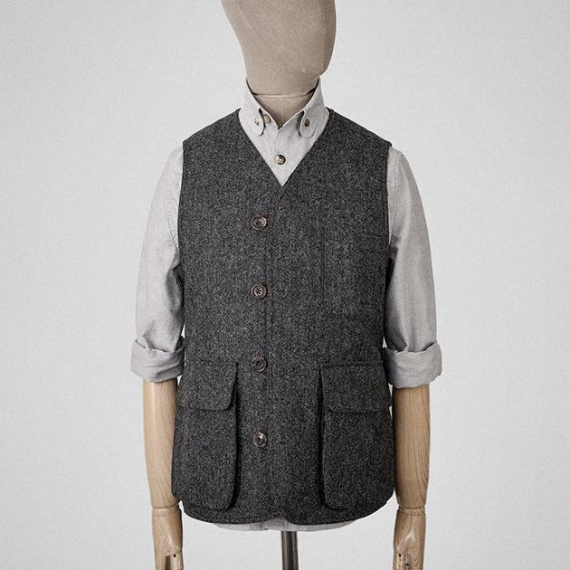 Charcoal-grey wool bellows vest.
