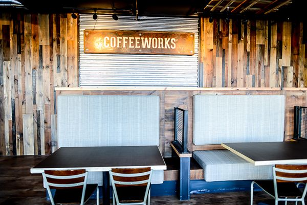 This coffee shop incorporates wood and metal to create an urban industrial feel. Natural materials to sell a natural product.