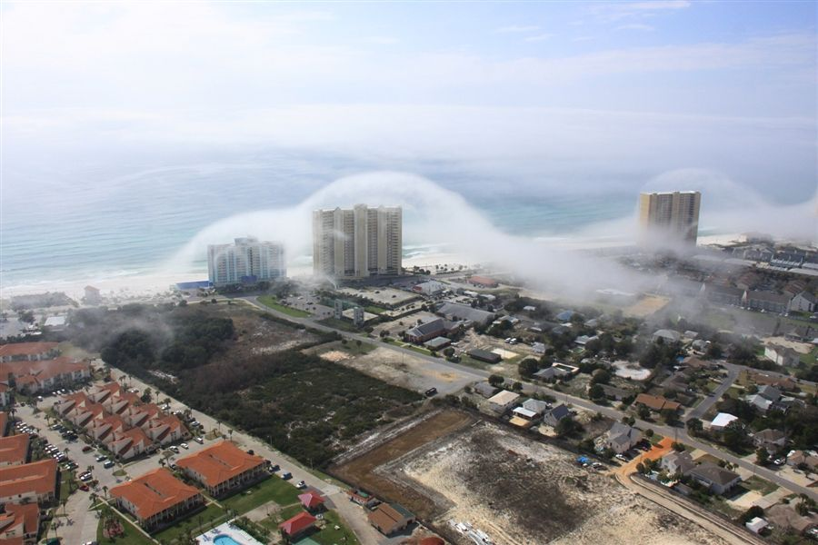 fog rolls up along the shore of panama city beach florida. Black Bedroom Furniture Sets. Home Design Ideas