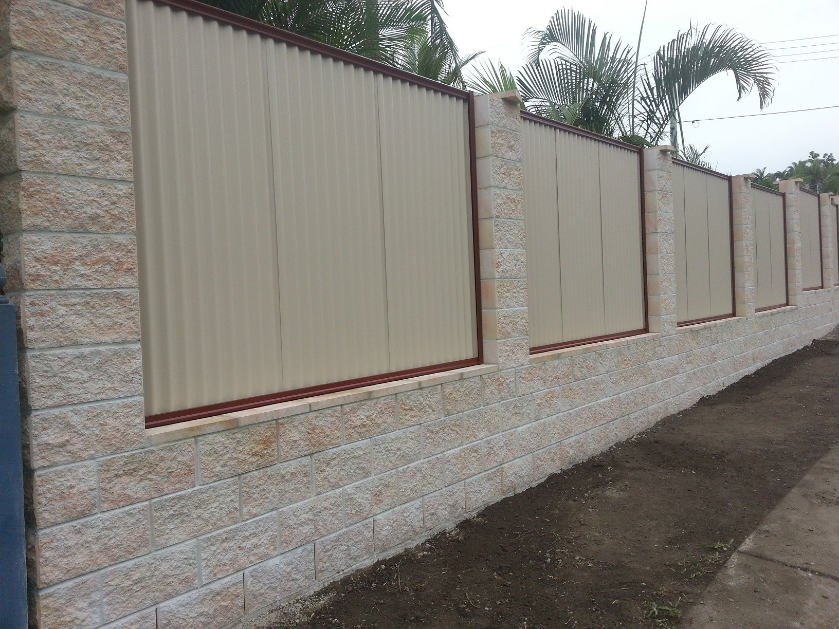 Elegant White Cement Block Fence Wall That Decorated With