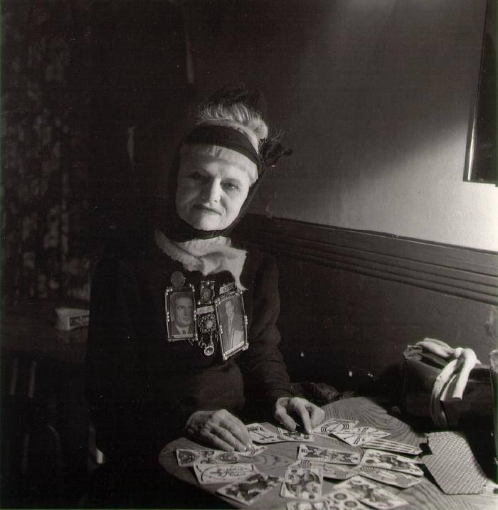 The Fortune Teller  by Robert Doisneau  Paris, 1951 using the French Marseille tarot deck