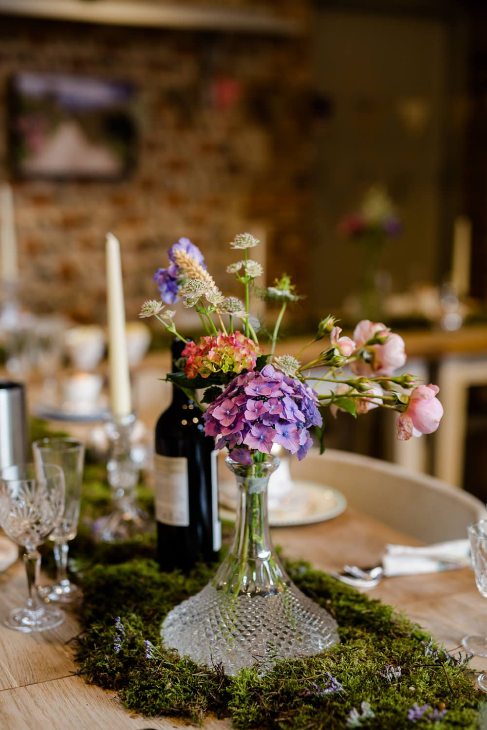 Moss table runner cut glass vase centrepiece back to the garden wedding venue in norfolk enchanted theme justin alexander bridal gown pastel also with