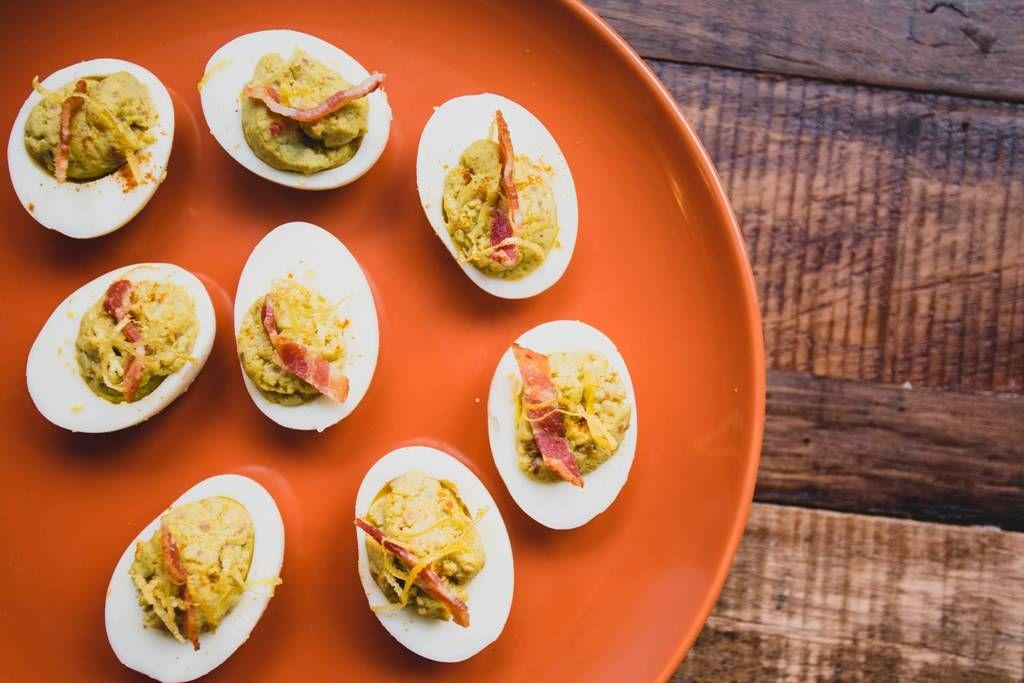 Bacon Avocado Deviled Eggs: Make sure your shopping list for brunch includes bacon, avocado & eggs. Trust us.