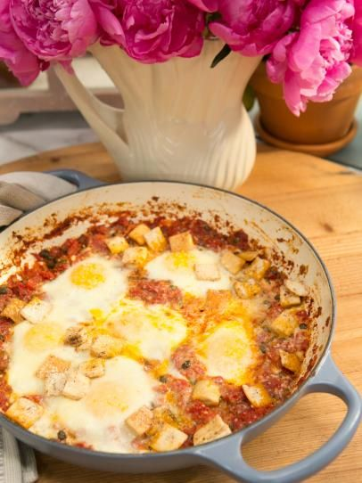 Baked eggs with green chiles and capers recipe breakfast by baked eggs with green chiles and capers recipe breakfast by shireen vasquez pinterest geoffrey zakarian egg and food forumfinder Images