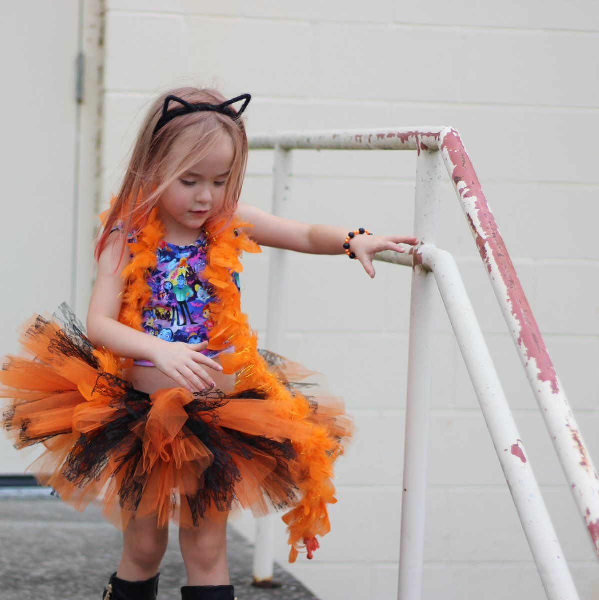 Looking for a simple yet elegant Halloween tutu  Our Orange and Black Lace  tutu is just that! Satin ribbon tie in the back for the perfect fit. 007fbdfe0593