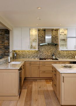 Light cabinets with very wide, weathered wood floor. Hate the upper cabinets and backsplash.