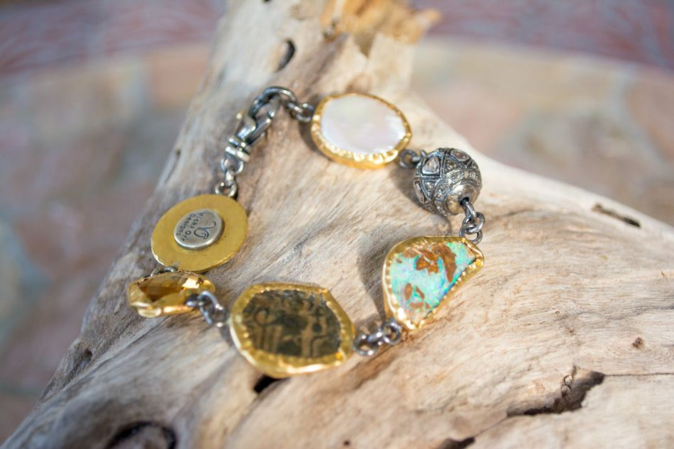 Bohemian bracelet links semi-precious stones and ancient coins together in a gorgeous design. Stones are surrounded by 22-24k gold and joined by sterling silver clasps. Each piece is a one-of-a-kind VO original.