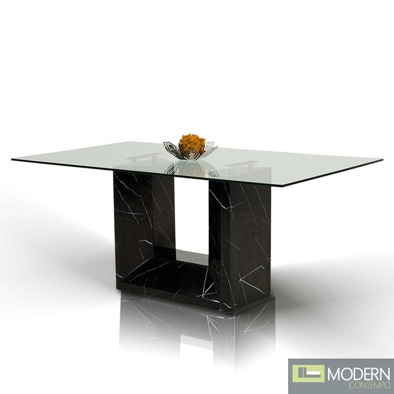 This dining table has U-shaped base with a black marble finish.