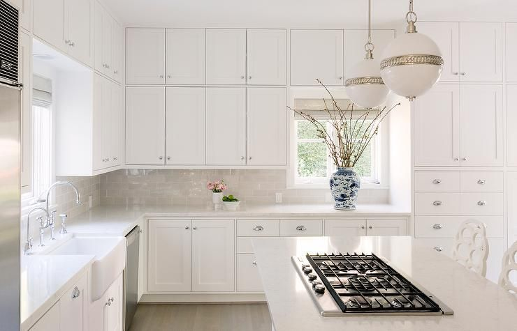 Best A White Kitchen Is Accented With Stacked Cabinets Adorned 400 x 300