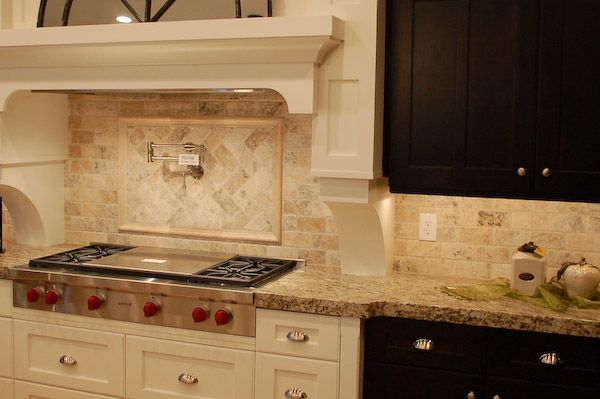 Travertine tile backsplash tiles give a clean contemporary look to this modern kitchen - Backsplash designs travertine ...
