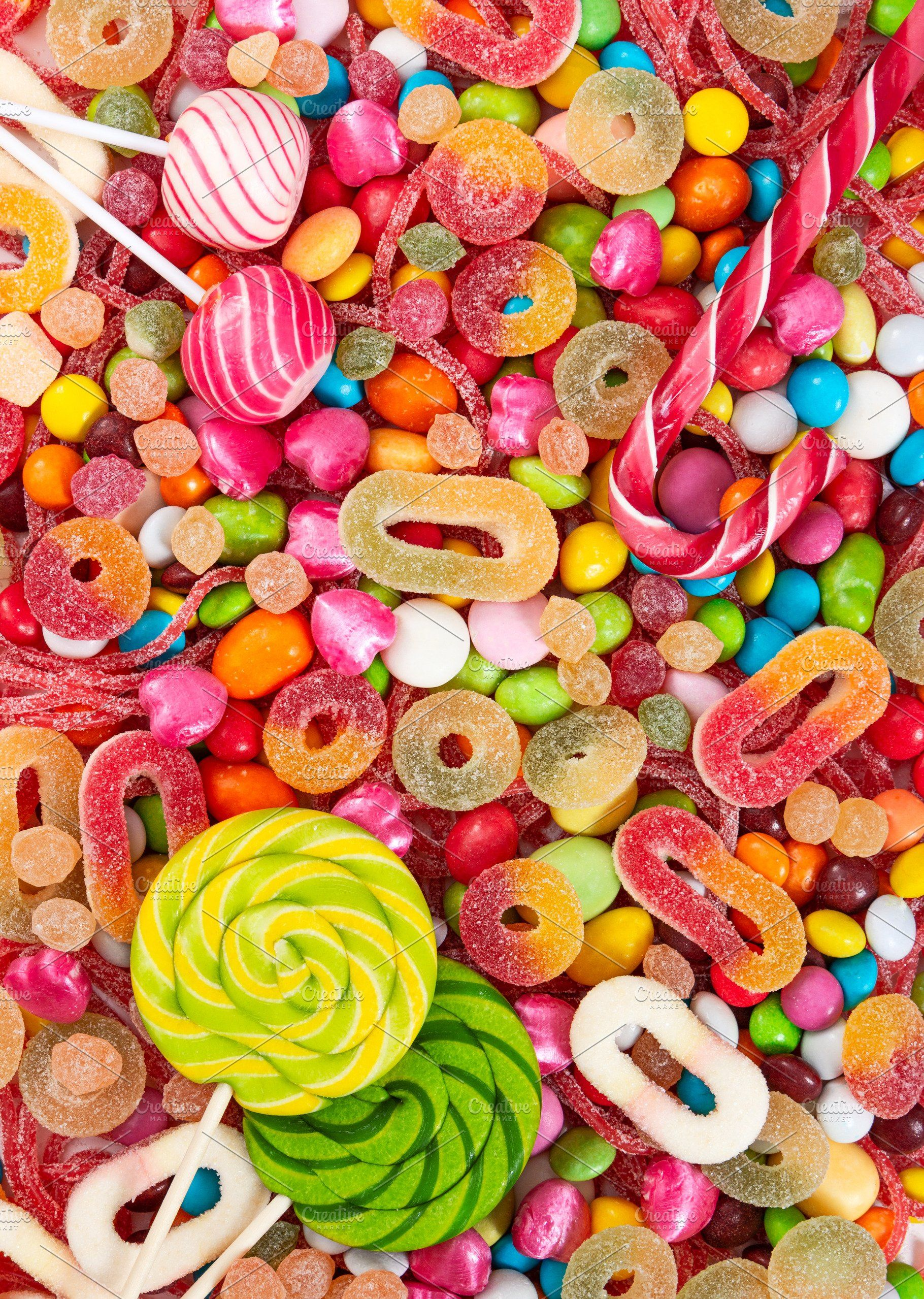 colorful lollipops and candies stock photo containing