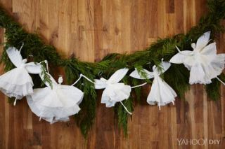 paper plate angel garland against wreath