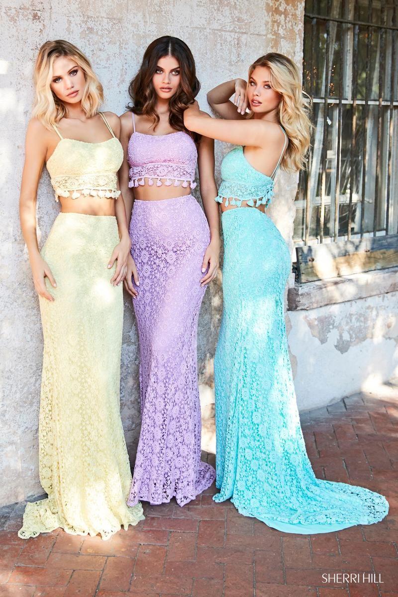 c3f22e45297 Boho prom dress by Sherri Hill style no. 52810. Lace two piece comes in  multiple colors! www.bravurafashion.com Bravura Fashion is located in  Marietta