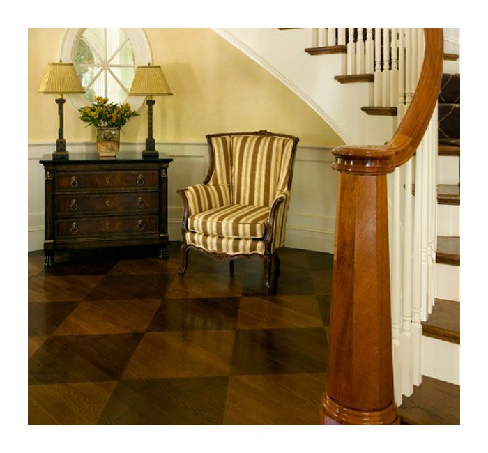 Laminate Flooring In A Diamond Pattern Gives Elegance To This Entryway Foyer Design Traditional Staircase