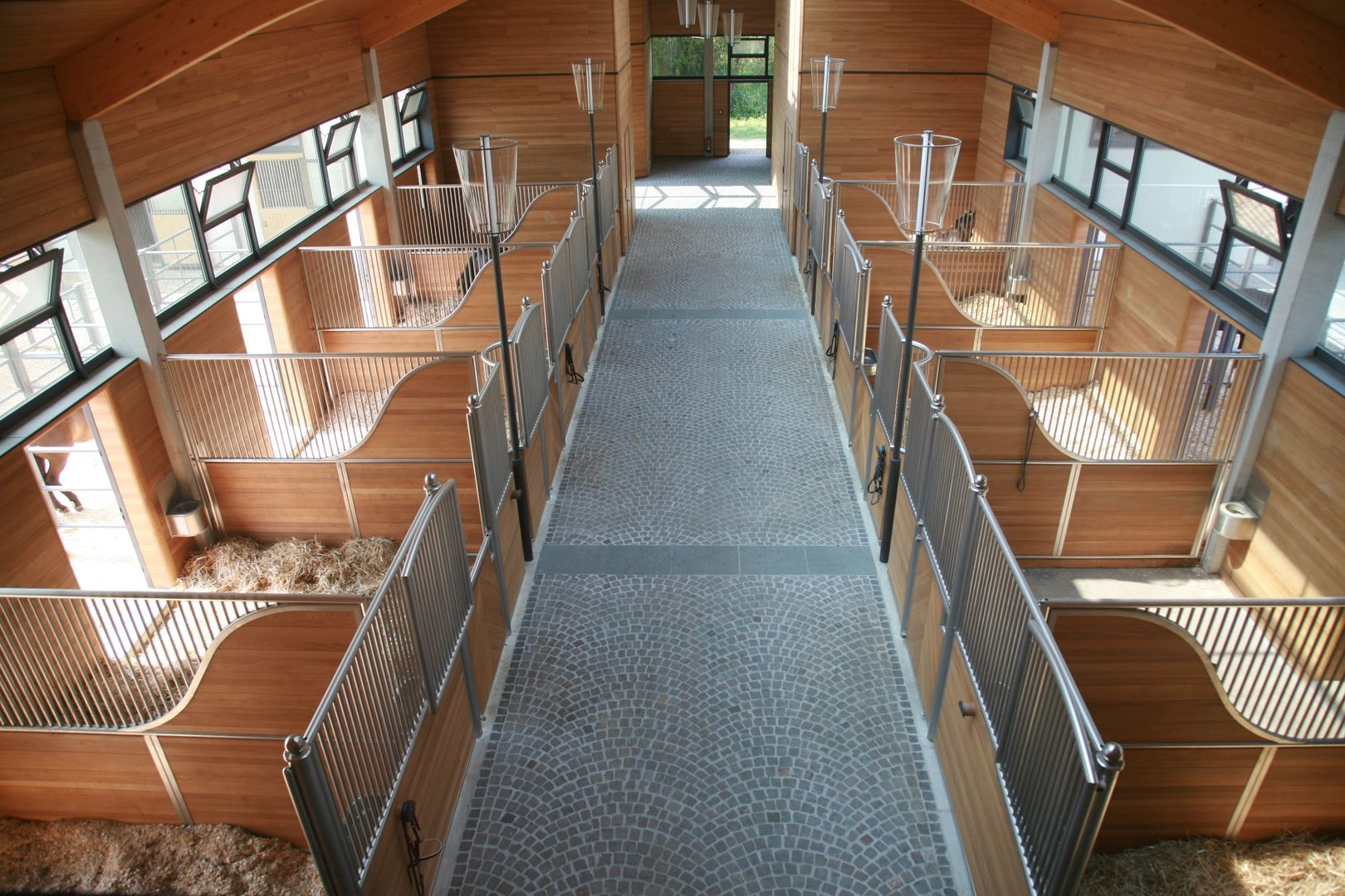 Stables in one of the horse barns at Hofgut Rosenau, Germany