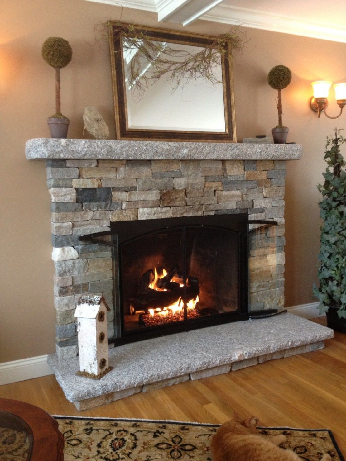 Remodelling light grey fireplace stone into field stone for natural