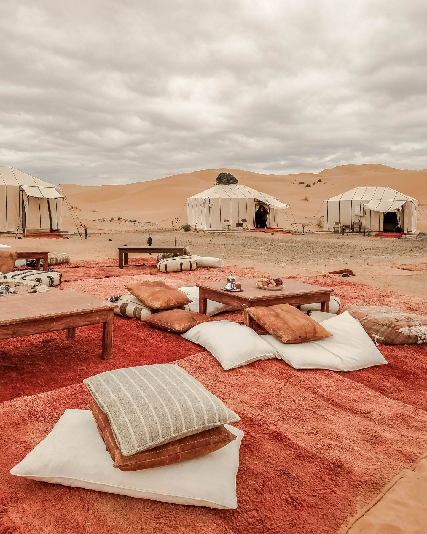 Click here to read about glamping at Merzouga Luxury Desert Camp in the Sahara Desert in Morocco. Sahara desert glamping in Morocco is unlike any other experience you'll have. You'll get to climb on sand dunes, ride camels, sandboard, and drink all the mint tea you can possibly stand. #moroccoglamping #saharadesert #minttea Morocco desert photography   Morocco desert   What to Buy in Morocco   Best Activities Morocco   Morocco things to do   Morocco Tea Set   Morocco Experiences   Silver Tea Set