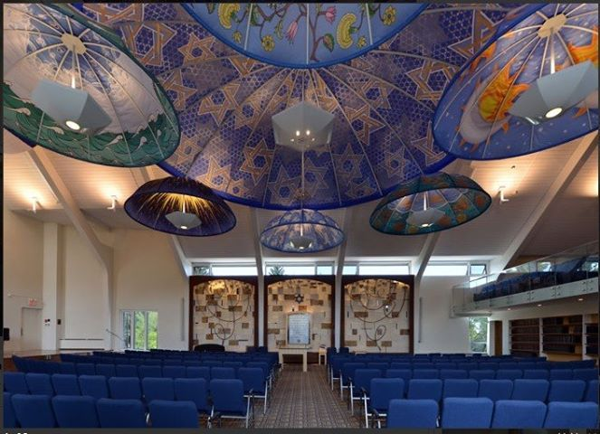 Temple B'nai Tikvah is a whimsical, joyous and serene place, unlike any other synagogue in Calgary. Dark wooden pews were removed and replaced with moveable chairs. The umbrella-like installation, created by artist Jeff Deboer, represents larger versions of the kippah, a head covering worn by members of the congregation during prayer. The large, central canopy symbolizes Shabbat, the Jewish holy day of rest that begins at sunset on Friday.   #calgaryfaith #jewish #worship #calgary