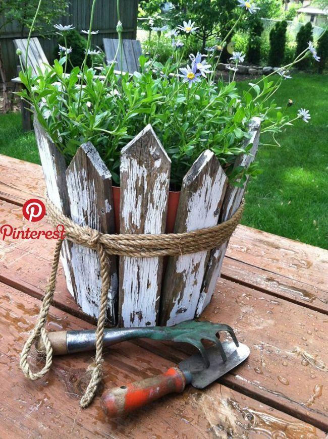 Use Cedar Fence Spindles Around Large Beige Planter Planter