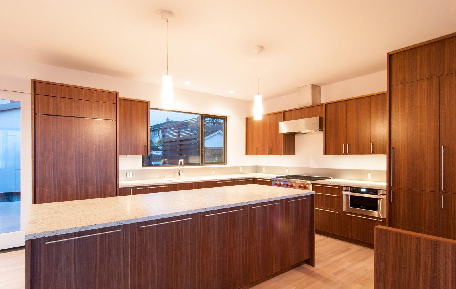 Modern Kitchen With Zebra Wood Cabinetry And White Countertops Interior Design Kitchen White Countertops Modern Kitchen