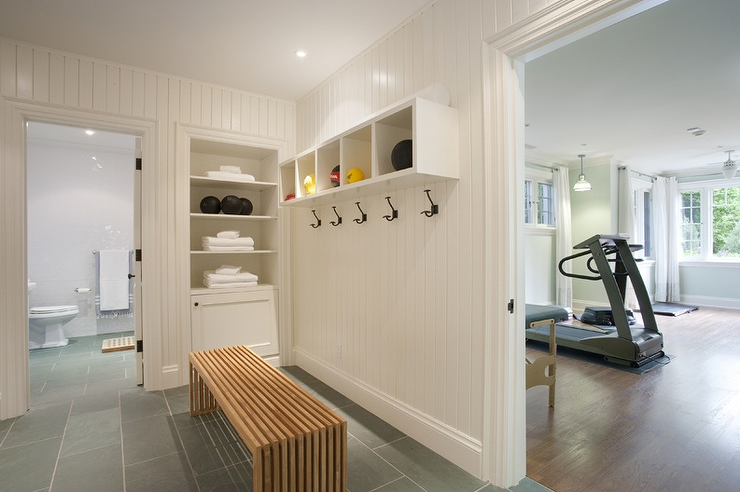 Home workout room changing area features vertical shiplap walls ...