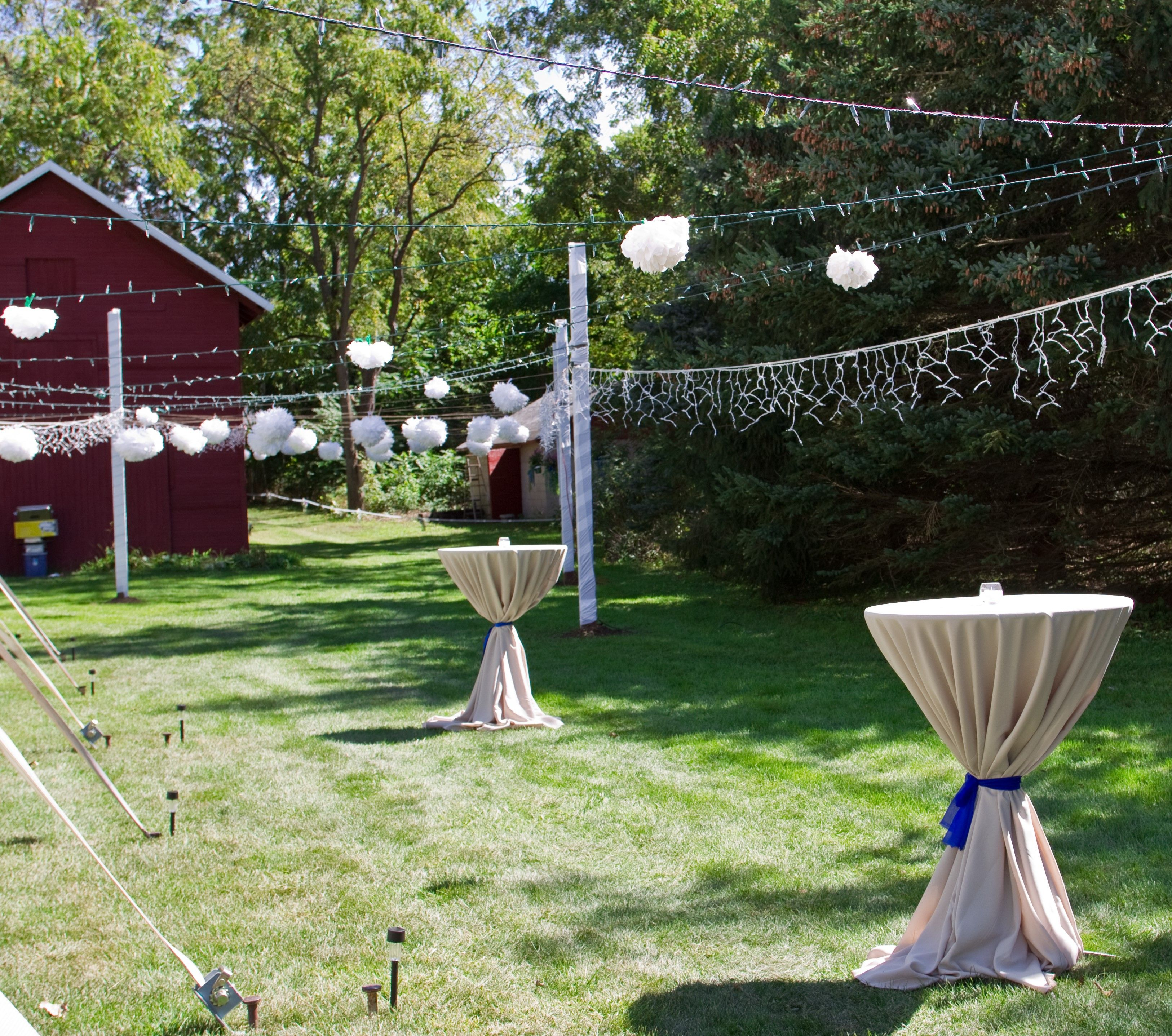 Cocktail Tables with Taupe Linens and Blue Ties String Lighting from Tent to Posts - & Cocktail Tables with Taupe Linens and Blue Ties String Lighting ...
