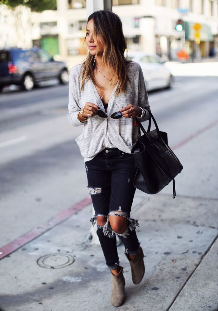 8a130592e3 These dark denim jeans are the epitome of distressed! Julie Sarinana rocks  this edgy style