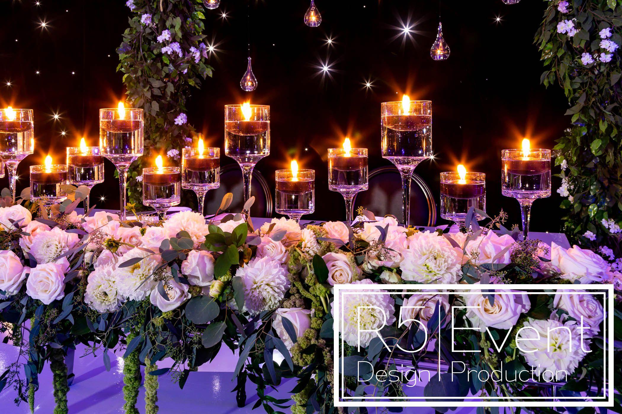 Lovely view of: black candles, full flower runner, greenery
