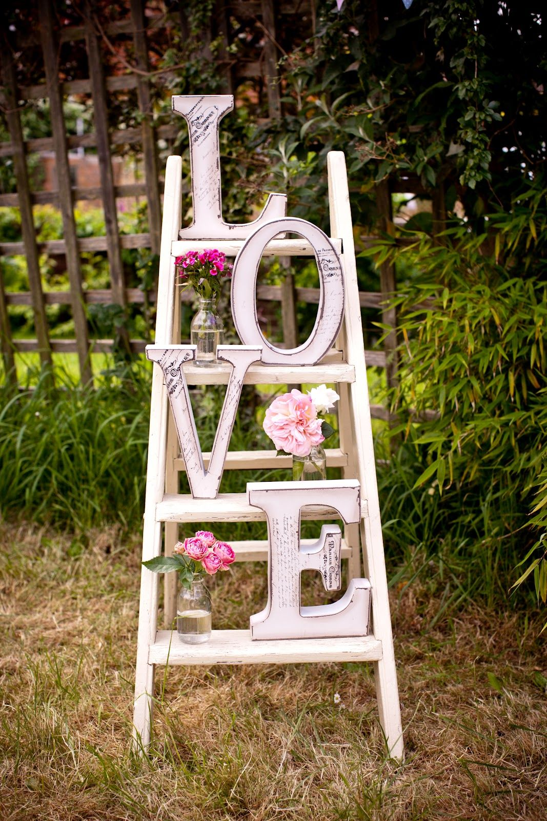 All white church wedding decor Literally LOVE this vintage display piece made with white ladder