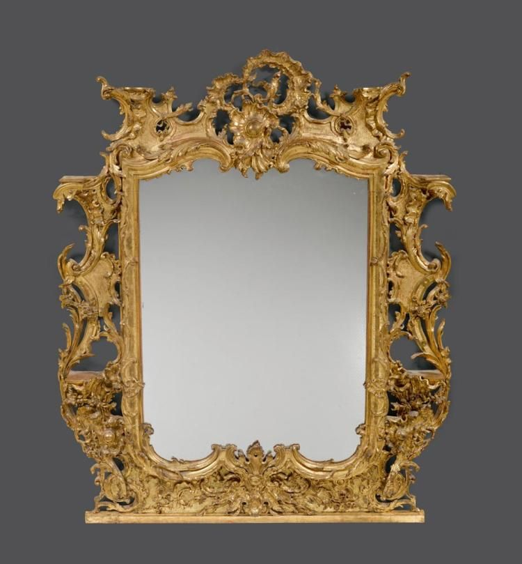 IMPORTANT MIRROR WITH CONSOLES FOR PORCELAIN FIGURES, Louis XV, probably Berlin, ca. 1760. Wood, pierced and exquisitely carved and gilt. Gilding, restored. Mirror glass, replaced - Dim: H 188 cm. W 150 cm.