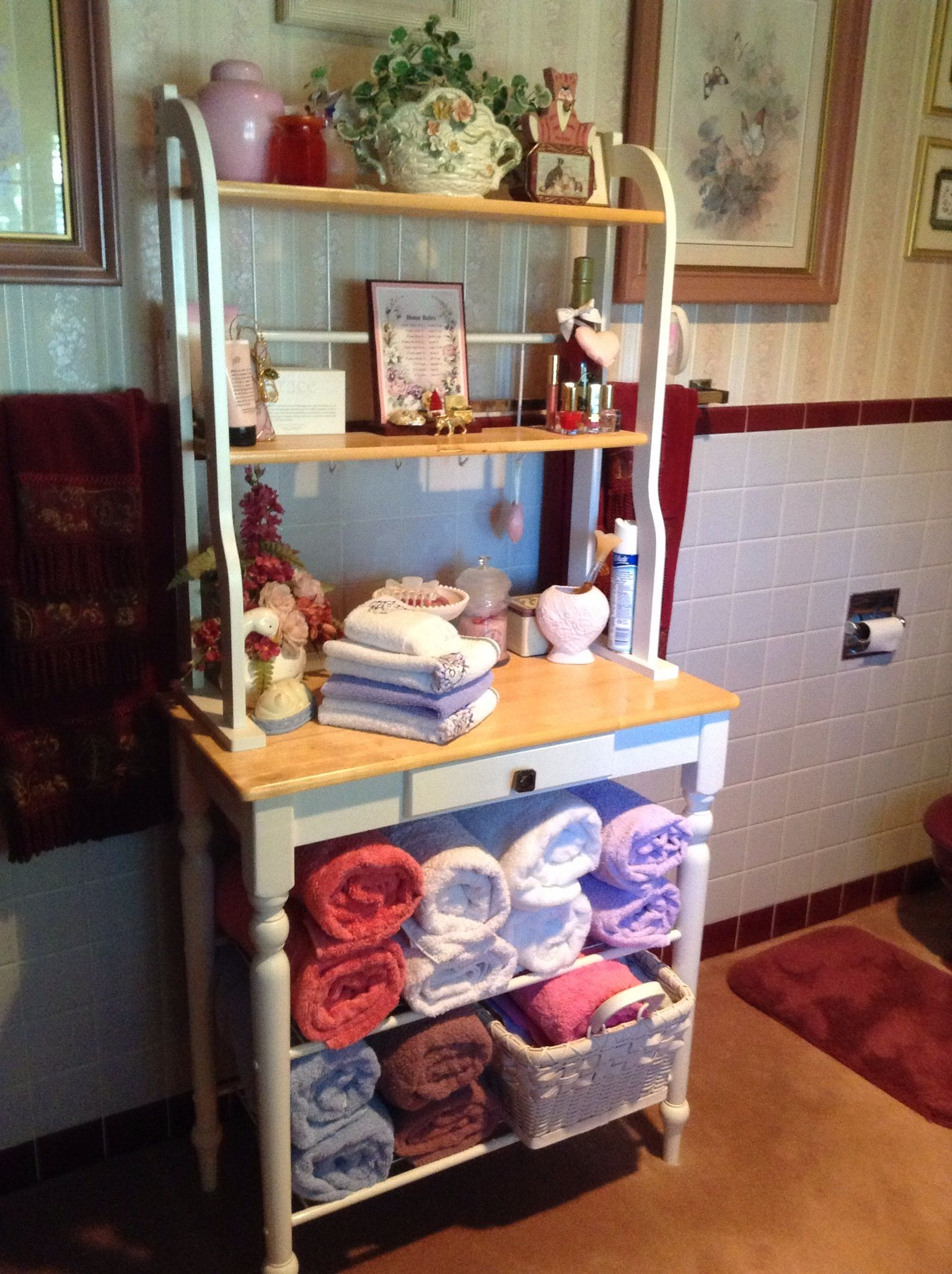 Baker S Rack Used For Towels And Etc In The Bathroom With
