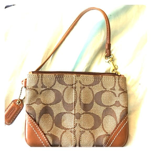 AUTHENTIC COACH WRISTLET % Authentic Coach Wristlet! Brown/tan and never been used. In great condition and is super cute to just run to the store or for a night out. Coach Bags Clutches & Wristlets