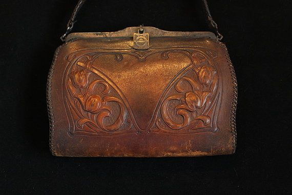 Check out this item in my Etsy shop https://www.etsy.com/listing/267509582/vintage-jemco-tooled-leather-purse-art