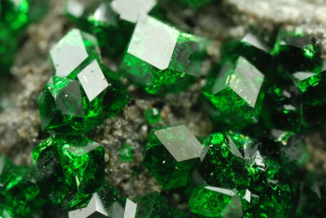 Some chromium silicate mineral with a really long name that I can't for the life of me remember. urvorite or something
