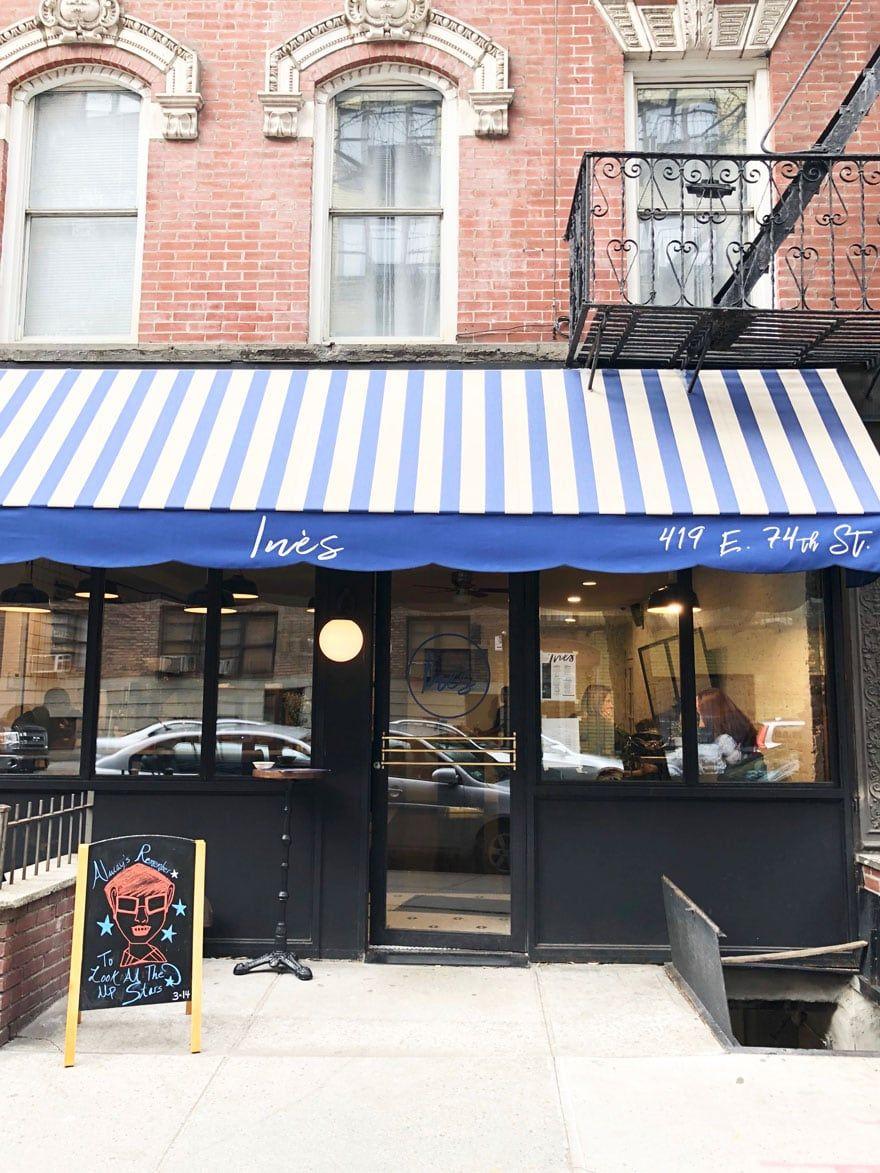 We Love A Striped Awning And This New French Cafe Called Ines On East 74th Street In Nyc French Cafe Nyc Coffee Shop Nyc Upper East Side