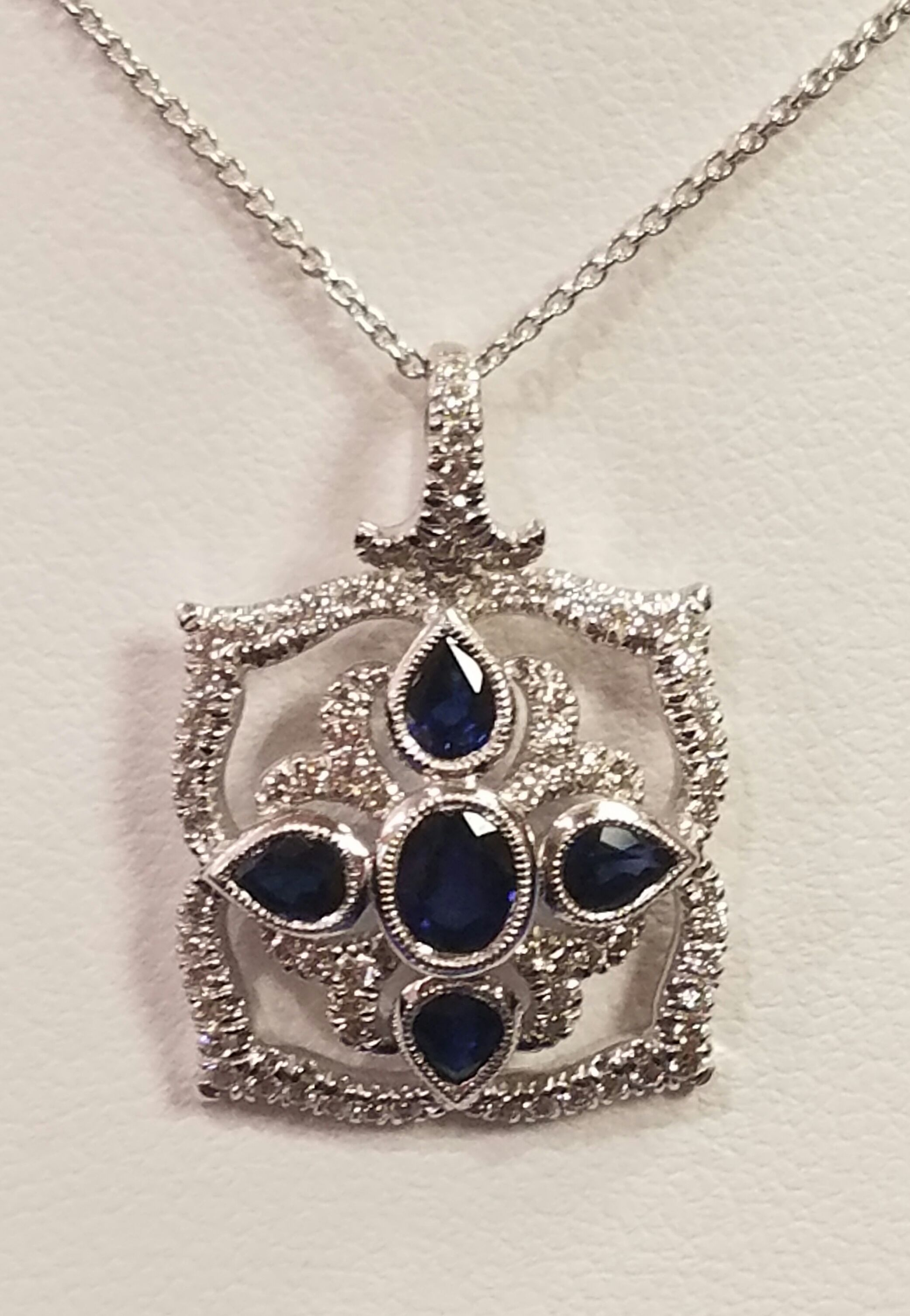 14kt white gold 5 sapphire and 78 diamonds necklace.