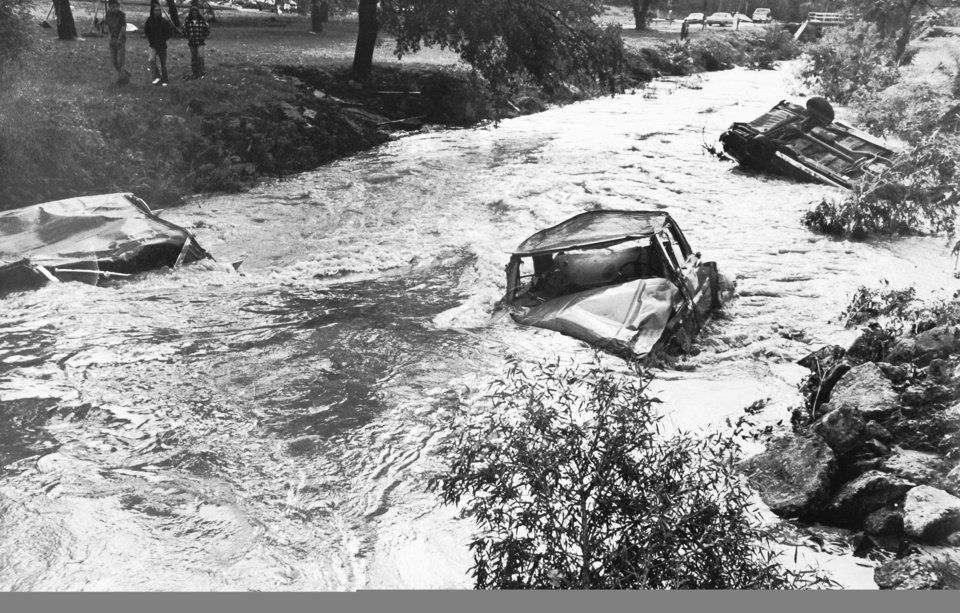 Floodwaters powered through this creek in a park leaving cars behind during the October 11, 1973, flood in Enid. <strong></strong>