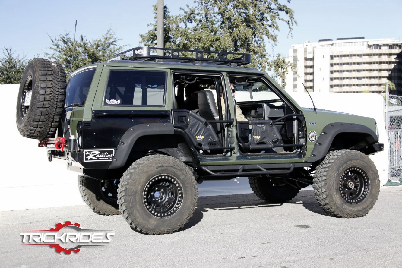1991 Jeep Cherokee At Sema Show Trickrides Sema Customcarshow Aftermarketaccessories Trickyourride Driver V Jeep Cherokee Xj Jeep Xj Mods Jeep Cherokee