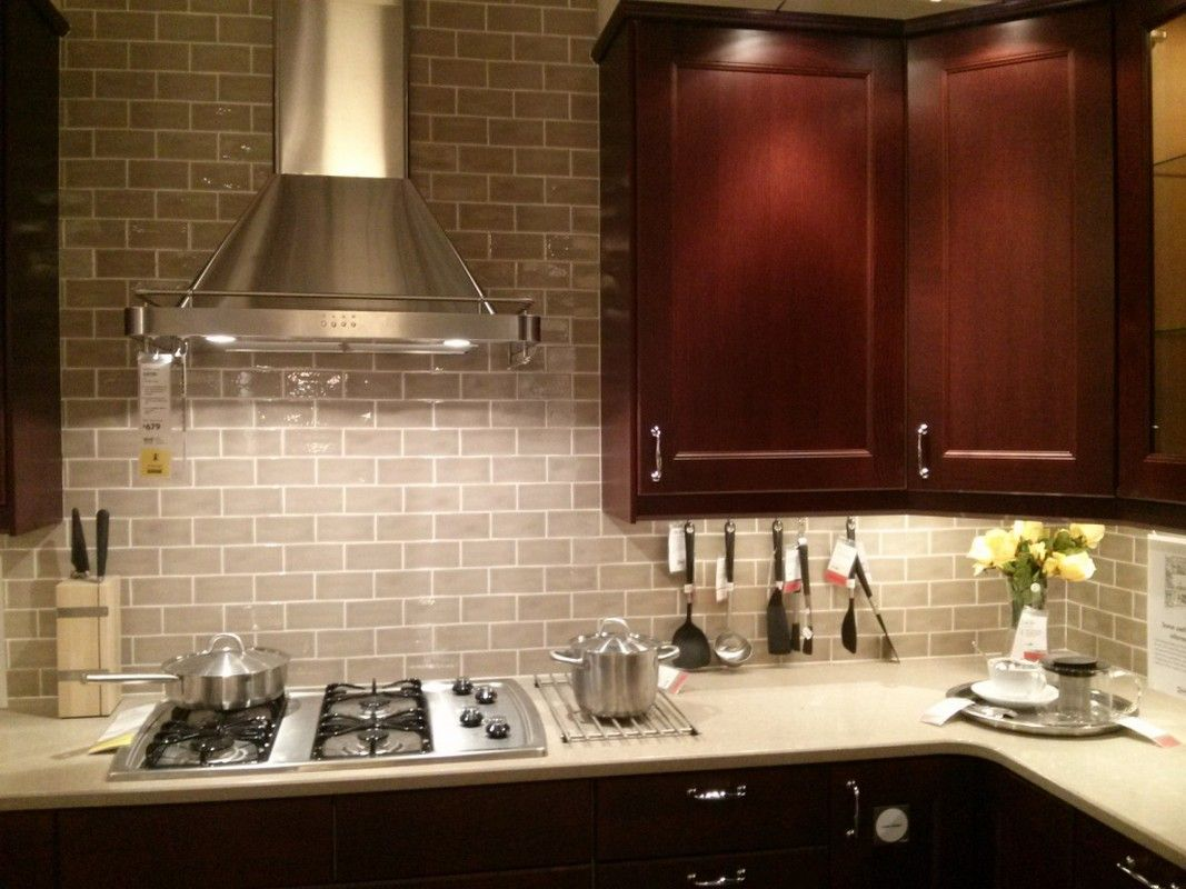 Love The Gray Subway Tile With The Cherry Cabs White Counter The Subway Tile Kitchen Tiles Backsplash Backsplash Tile Design Subway Tile Backsplash Kitchen