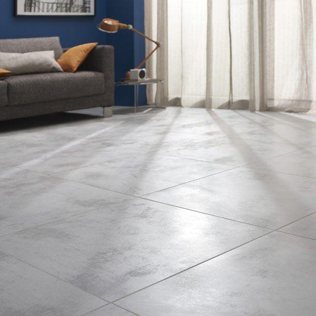 salon avec carrelage gris, mur gris-beige - allié à un canapé gris - couleur cuisine avec carrelage beige