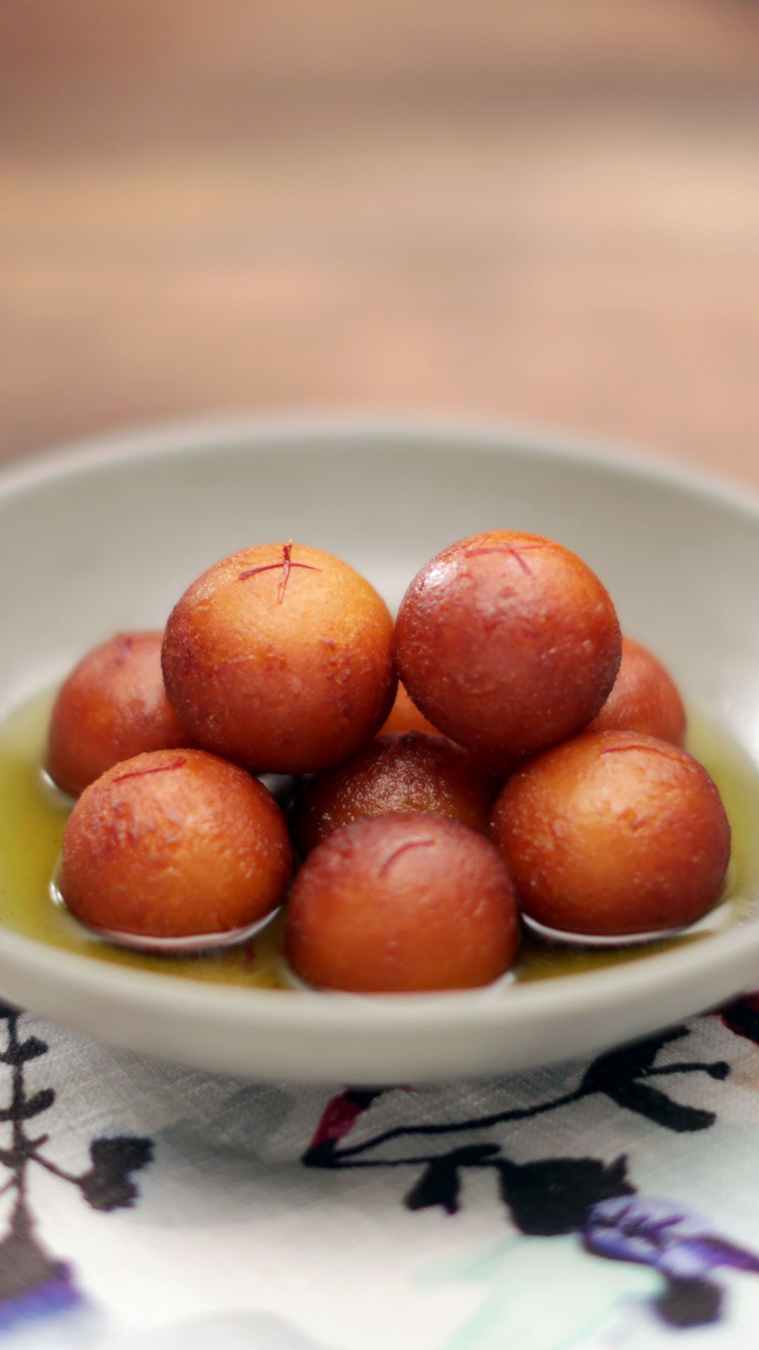 Soaked in sweet syrup, these Indian-style doughnuts can be enjoyed warm, hot or cold!