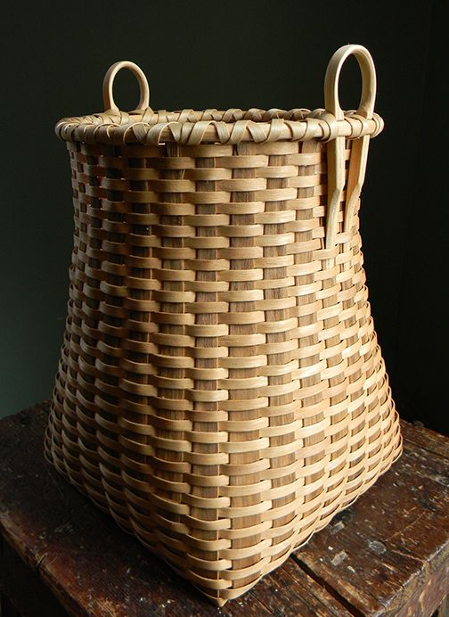 Table basket by Jamin Uticone. Black and white ash.