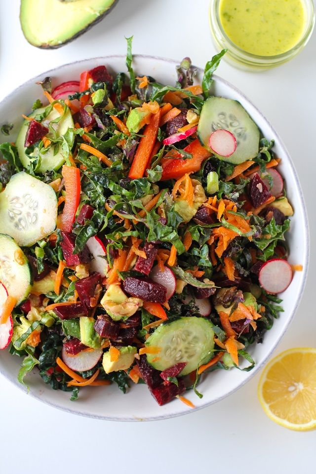 A vibrant detox salad with kale, carrots, bell pepper, radishes, cucumber, avocado, walnuts, beets, and lemon-parsley vinaigrette. This flavorful salad is packed with vitamins, minerals, antioxidan…