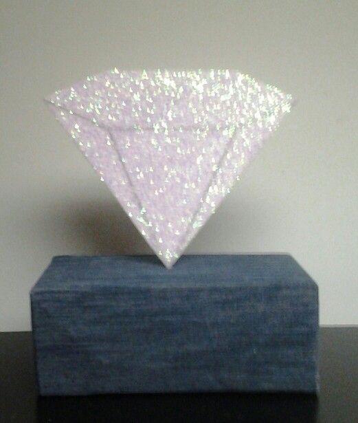 Styrofoam diamond on top of a cardboard box covered in denim jean ...